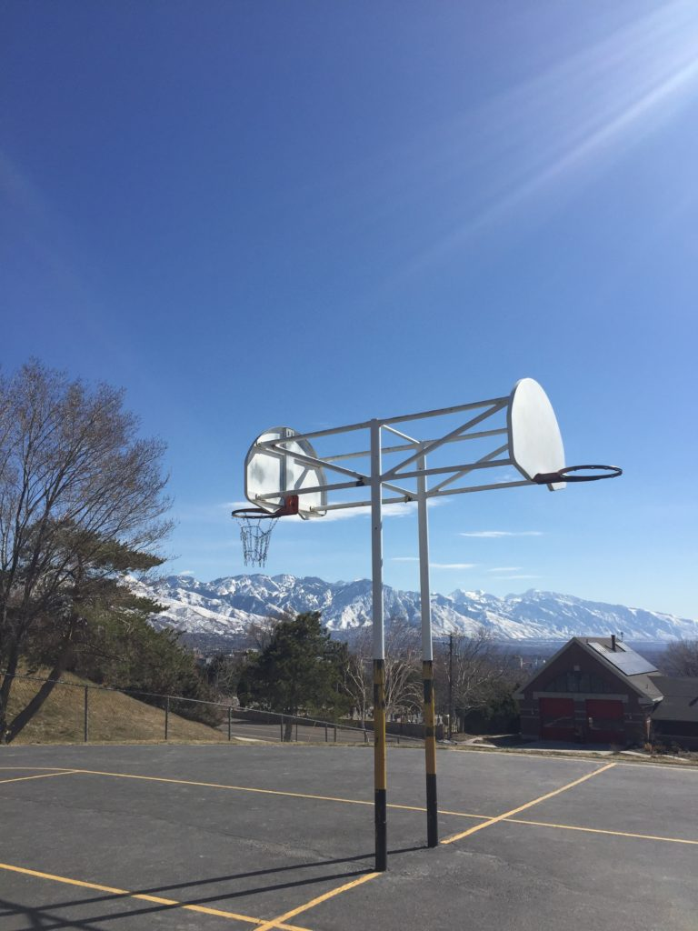 rose mattson - basketball hoop and mountains